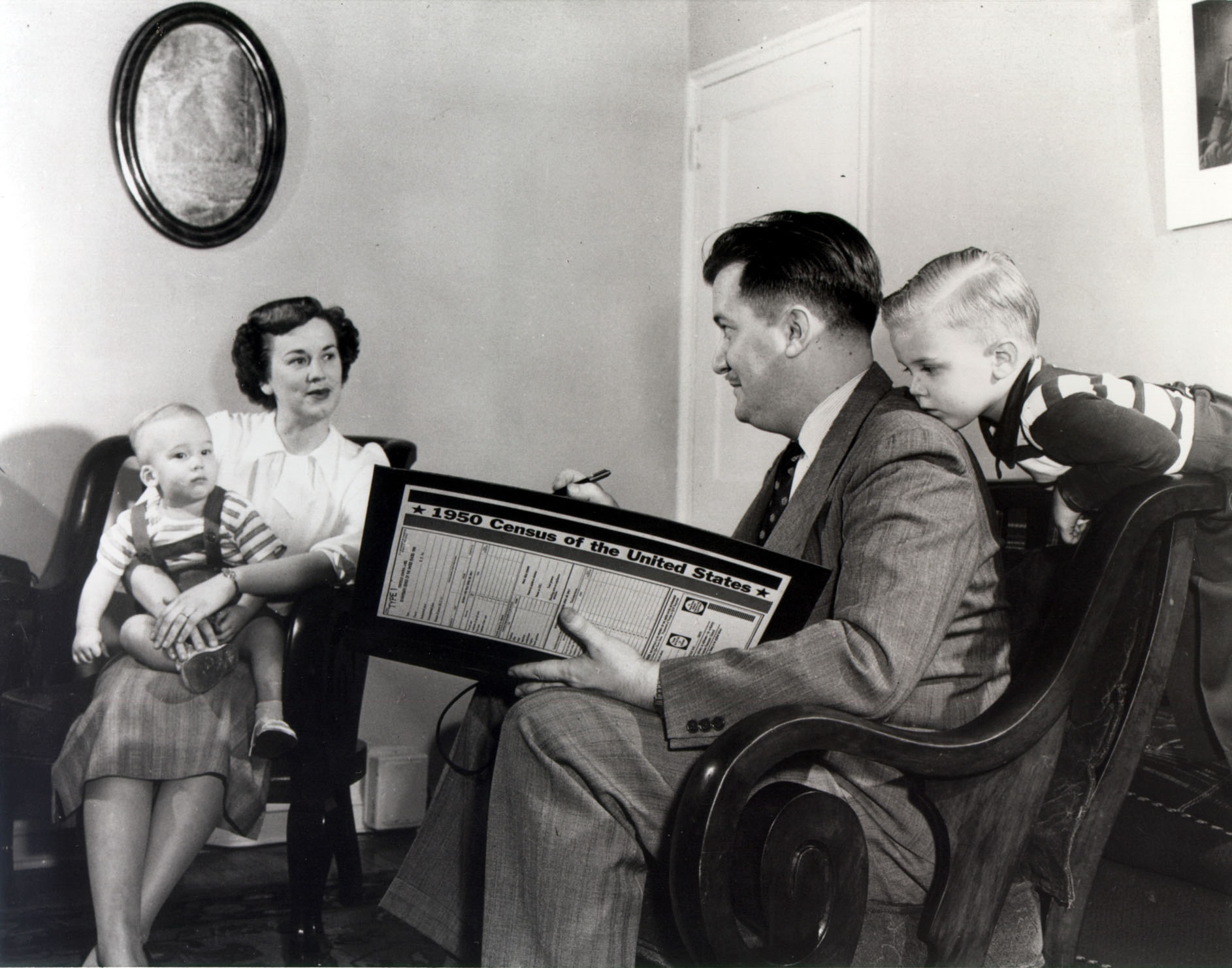 Census enumerator in 1950 interviewing a family